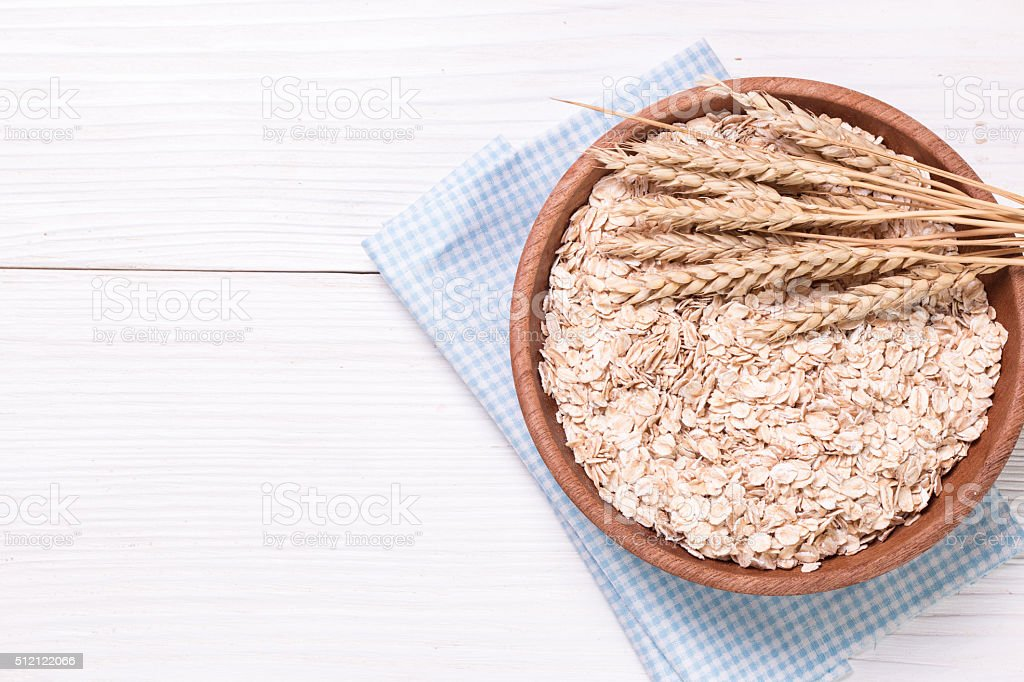 oat flakes on wooden table.healthy food concept. stock photo
