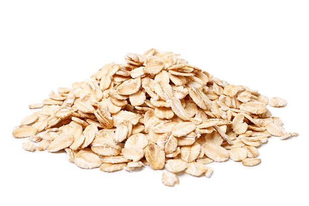 Oat flakes Oat flakes on white background oatmeal stock pictures, royalty-free photos & images