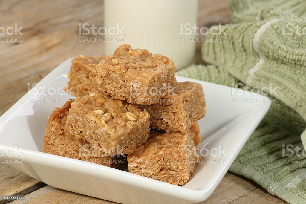 oat flapjack pieces with milk stock photo