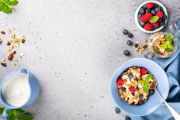Oat granola with berries and yoghurt stock photo