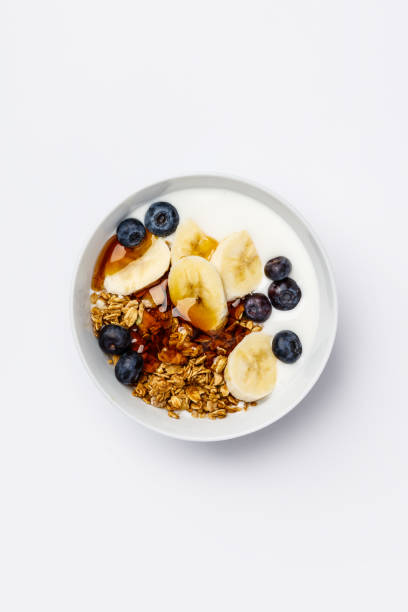 Oat granola with fresh blueberries, banana, yogurt and maple syrup stock photo