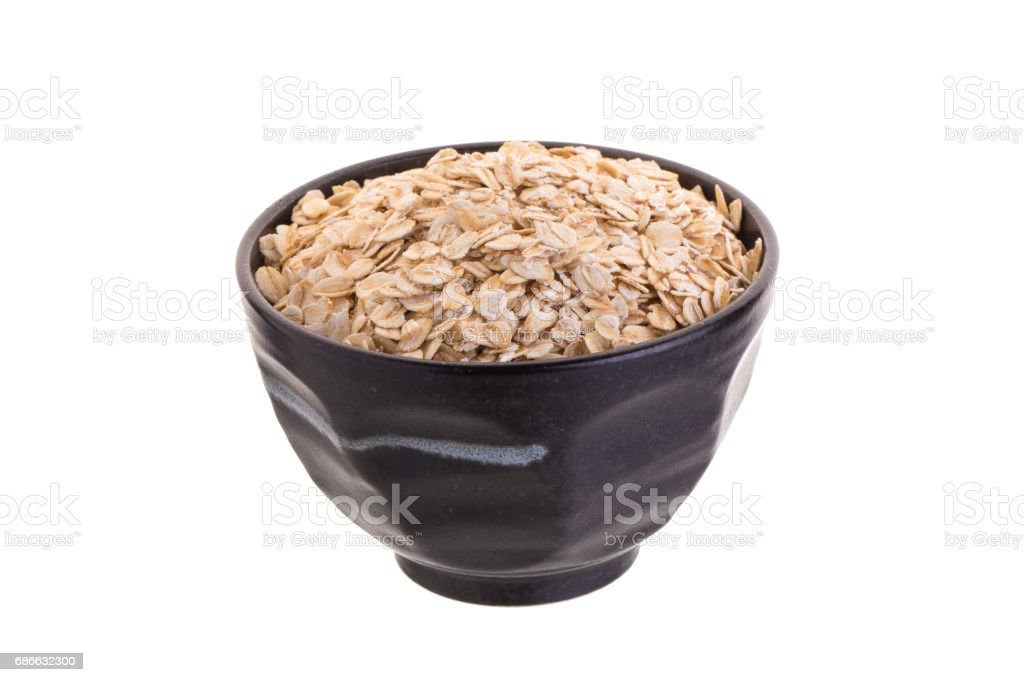 Oat in Black bowl isolated on a white background royalty-free stock photo