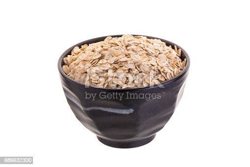 Oat In Black Bowl Isolated On A White Background Stock Photo & More Pictures of Agriculture