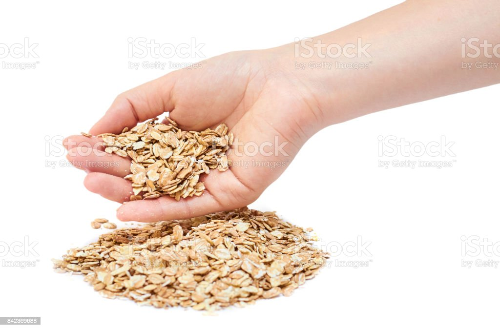 oat in woman's hand isolated on white background stock photo