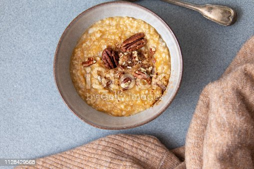 Oat porridge topped with pecan nuts and sweet Potatoes
