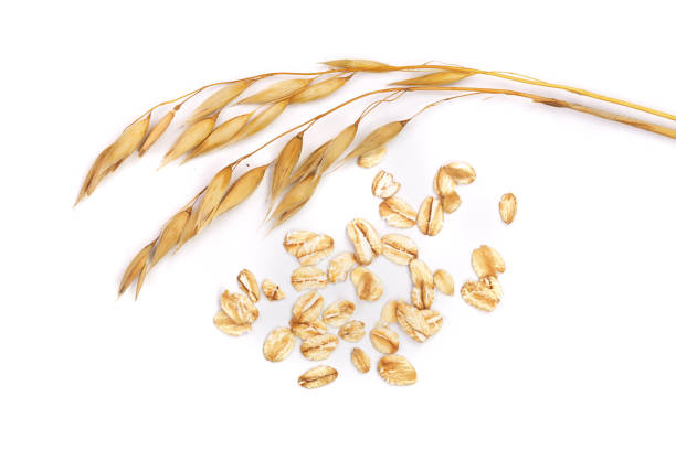 oat spike with oat flakes isolated on white background oat spike with oat flakes isolated on white background. oat crop stock pictures, royalty-free photos & images