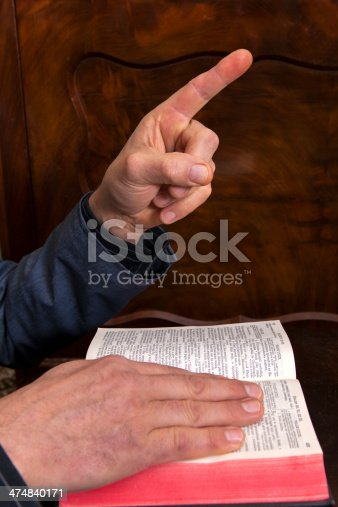 Oath on the Holy Bible against the dark furniture