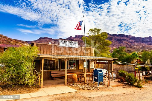 Oatman Historic US Post Office in Oatman, Arizona, United States. The colorful picture shows the post office located at famous Highway Route 66 in front of the black mountains.