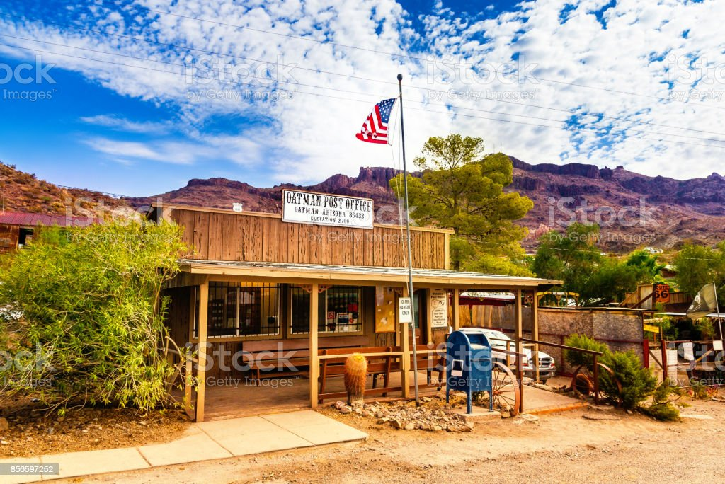 Oatman Historic US Post Office in Oatman, Arizona, United States. The colorful picture shows the post office located at famous Highway Route 66 in front of the black mountains. stock photo