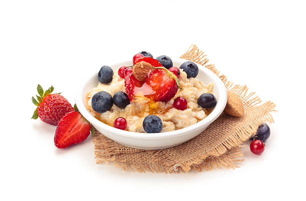 oatmeal and fresh fruits. - oats food stock photos and pictures