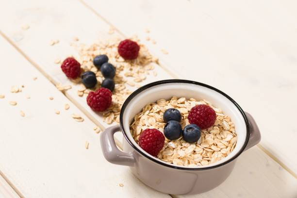 Oatmeal and raspberries and blueberries stock photo
