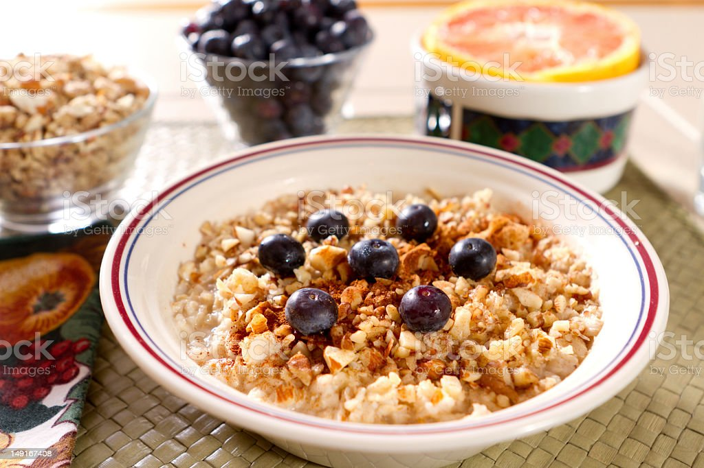 Oatmeal, blueberries, gound nuts and grapefruit breakfast royalty-free stock photo
