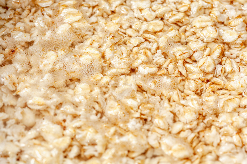 Oatmeal boiling , cereals preparation for breakfast
