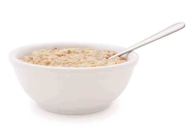 oatmeal schüssel und löffel (with path) - getreidebrei stock-fotos und bilder
