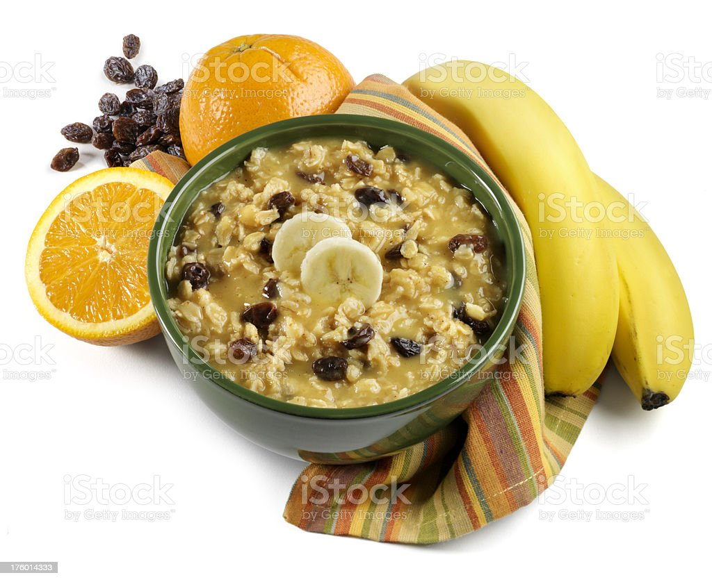 Oatmeal cereal with bananas and orange, white background royalty-free stock photo
