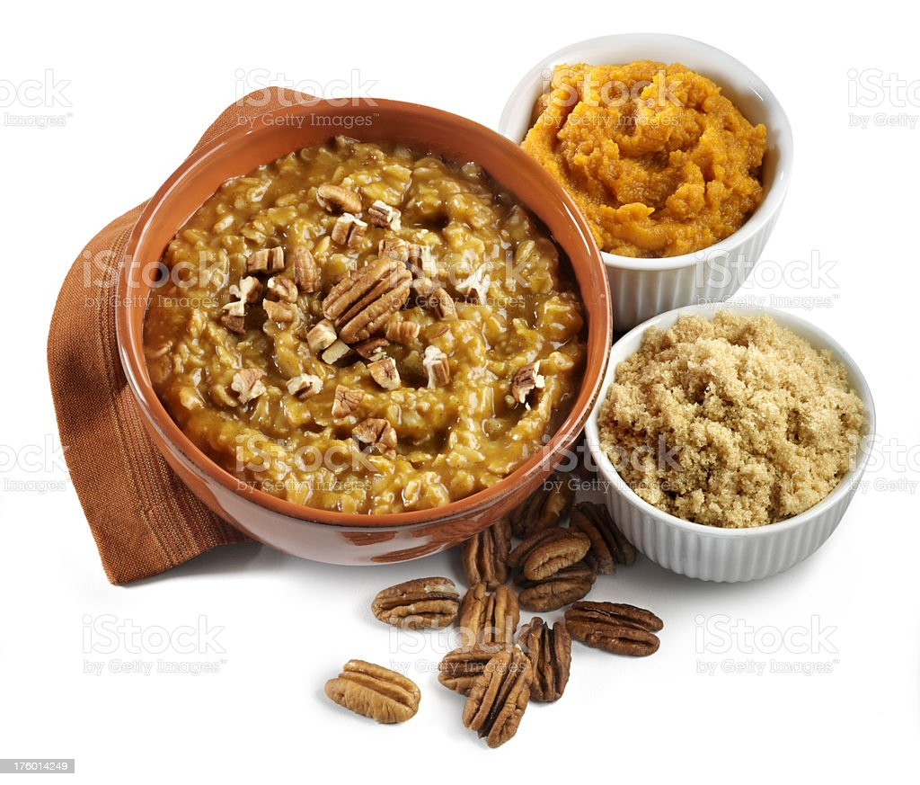 Oatmeal cereal with pumpkin and brown sugar, isolated royalty-free stock photo
