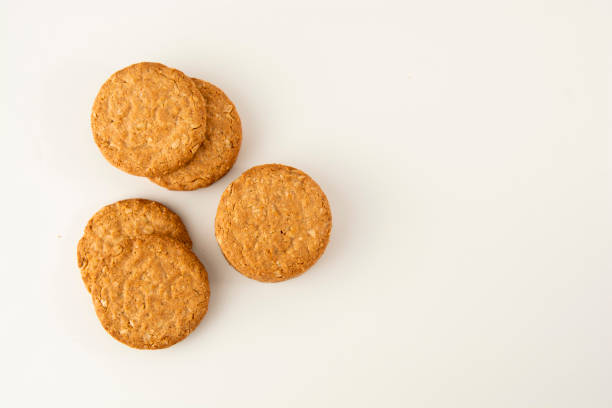 Oatmeal cookie isolated on white. Healthy round cookies. Oatmeal cookie isolated on white. Top view. biscuit stock pictures, royalty-free photos & images