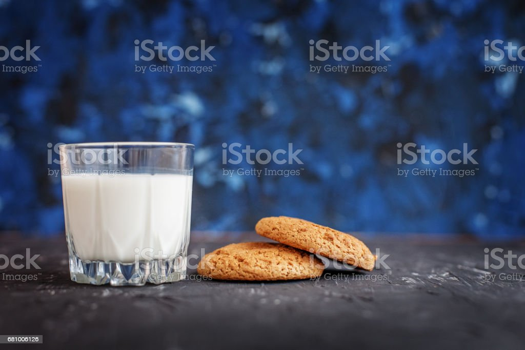 Oatmeal cookies and a glass of milk. The concept of healthy eating and vegetarianism. royalty-free stock photo