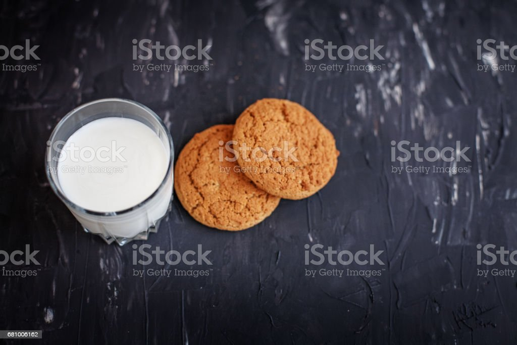 Oatmeal cookies and fresh milk. Top view. The concept of healthy eating and vegetarianism. royalty-free stock photo