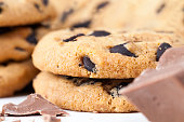 istock oatmeal cookies and large pieces of sweet chocolate 1331784130