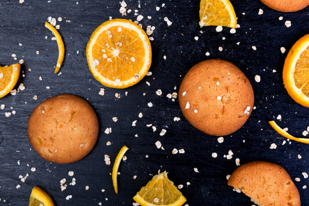 Oatmeal cookies and orange citrus fruit background. Flat lay stock photo