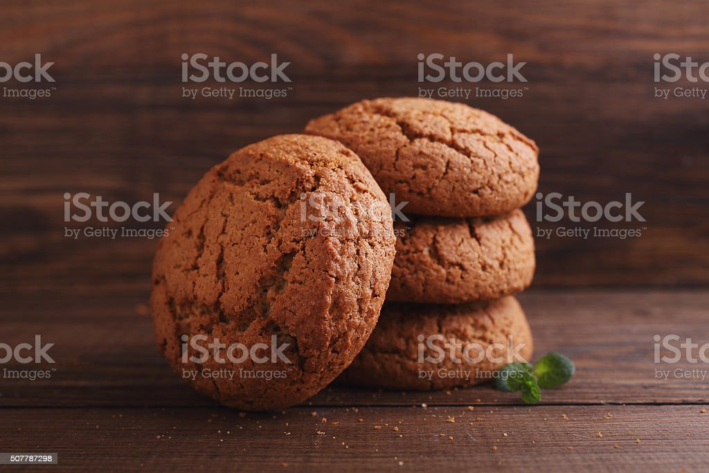 oatmeal cookies on a dark wooden background stock photo