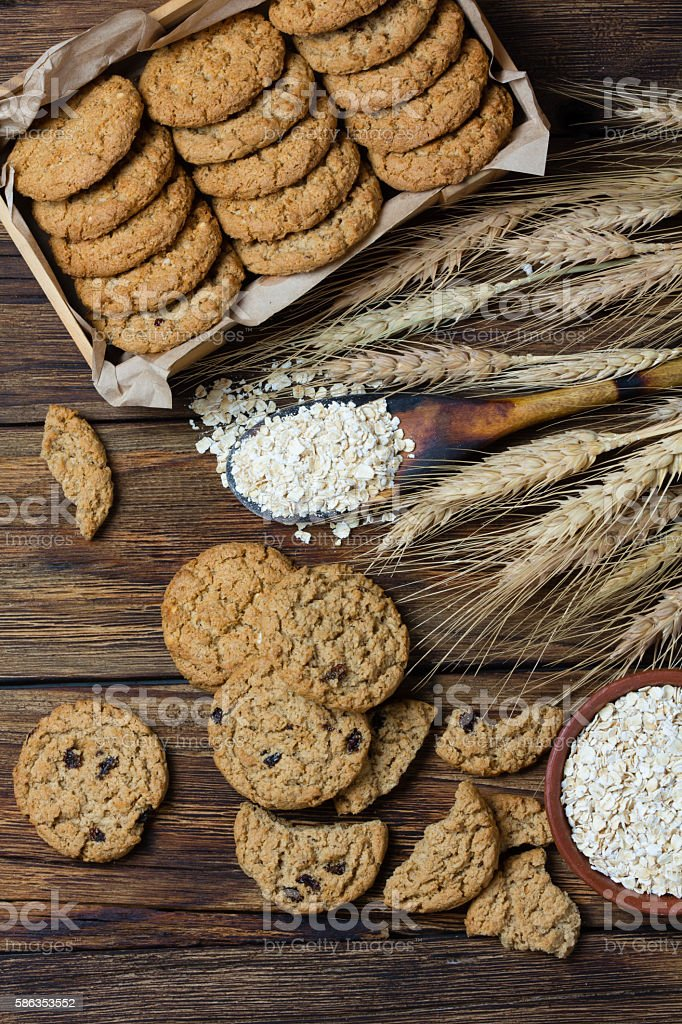 Oatmeal cookies on wooden background in rustic style stock photo