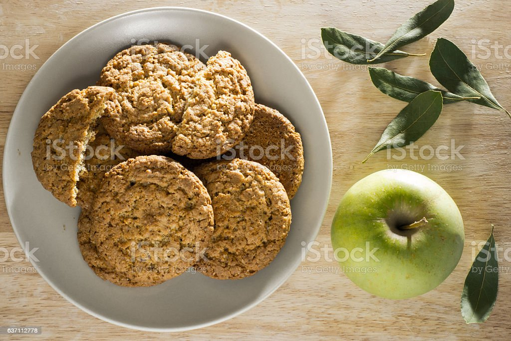 Oatmeal cookies with apple and bay leaf top view stock photo