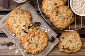 istock Oatmeal cookies with chocolate served with milk 1060555108