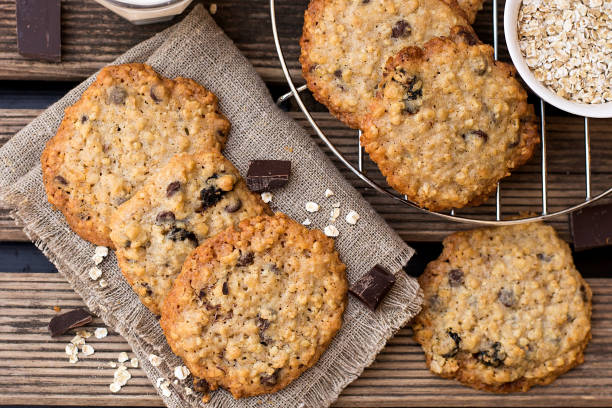 Oatmeal cookies with chocolate served with milk Sweet oatmeal cookies with chocolate served with milk chocolate chip cookie stock pictures, royalty-free photos & images