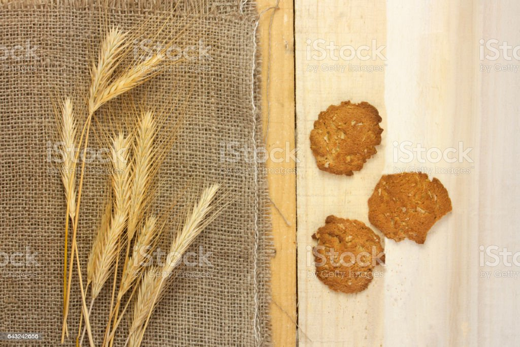 Oatmeal cookies with crops on burlap fabric with copyspace stock photo