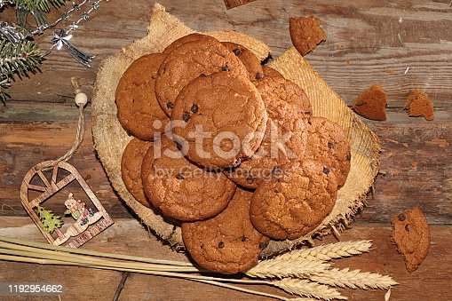 Oatmeal cookies with ears on an old wooden table, the concept of a traditional bakery, selective focus, flat lay. Useful natural breakfast without preservatives, healthy lifestyle, rustic style