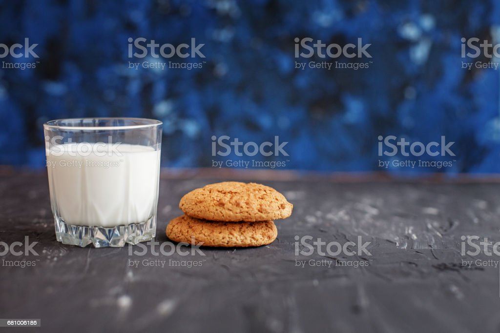 Oatmeal cookies with milk for breakfast. The concept of healthy eating and vegetarianism. royalty-free stock photo
