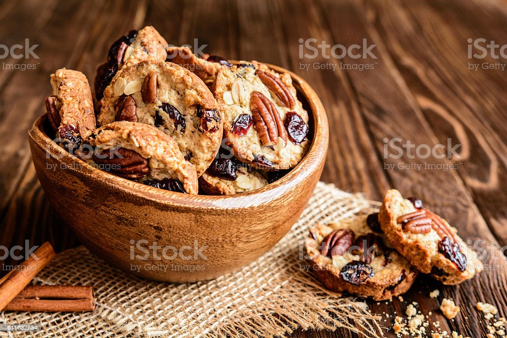 Oatmeal cookies with pecan nuts, cranberries and honey stock photo