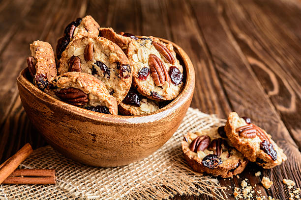 oatmeal cookies with pecan nuts, cranberries and honey - nusskekse stock-fotos und bilder
