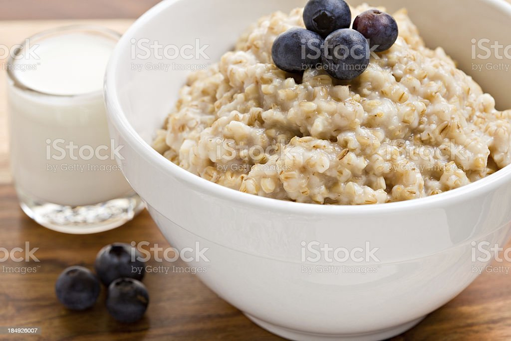 Oatmeal Fresh Cream and Blueberries royalty-free stock photo