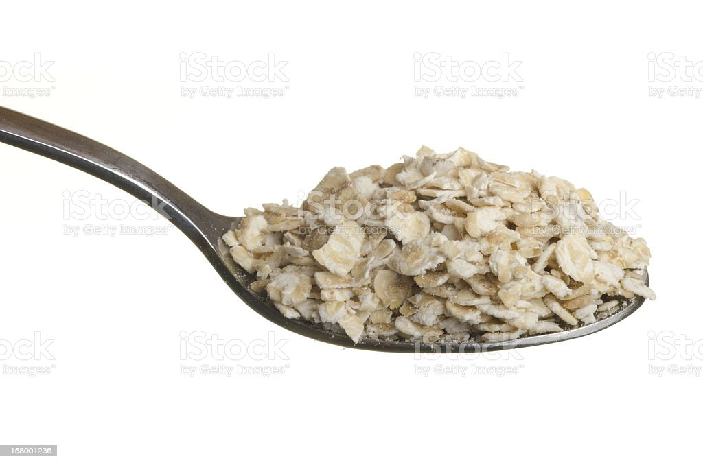 Oatmeal in a spoon stock photo