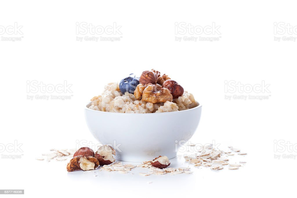Oatmeal porridge in bowl stock photo