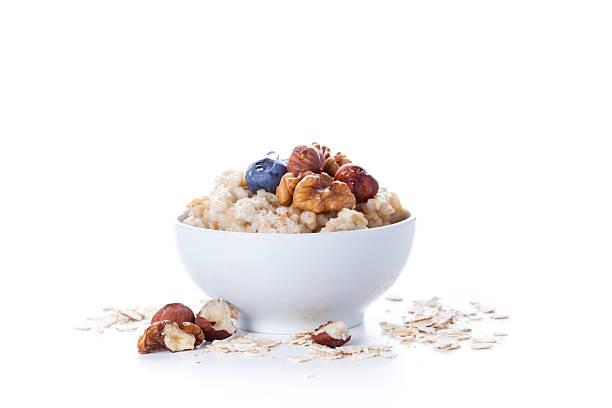 Oatmeal porridge in bowl stock photo