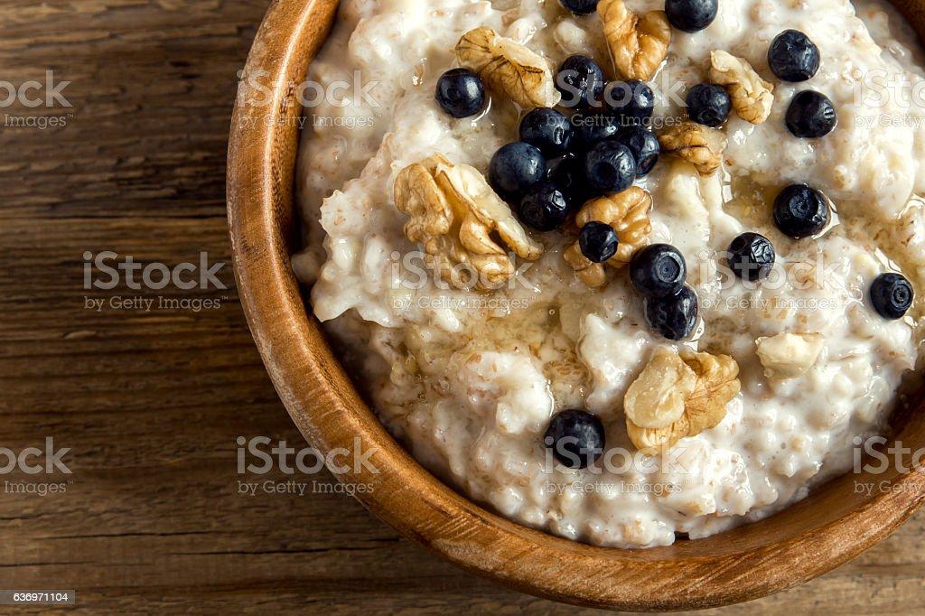 Oatmeal porridge with walnuts, blueberries stock photo