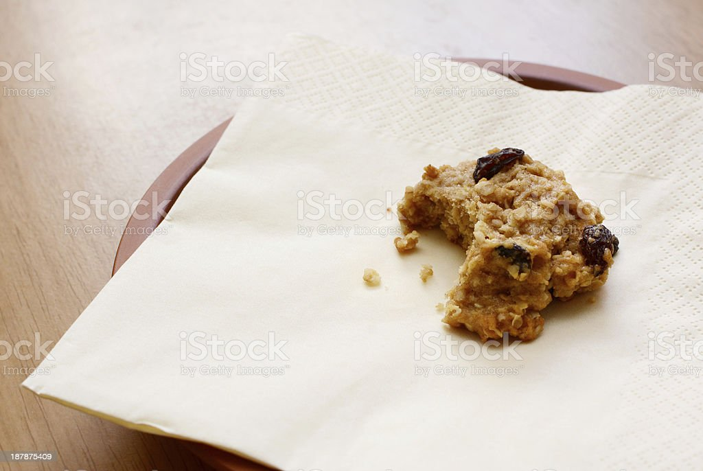 Oatmeal raisin cookie with a bite taken stock photo