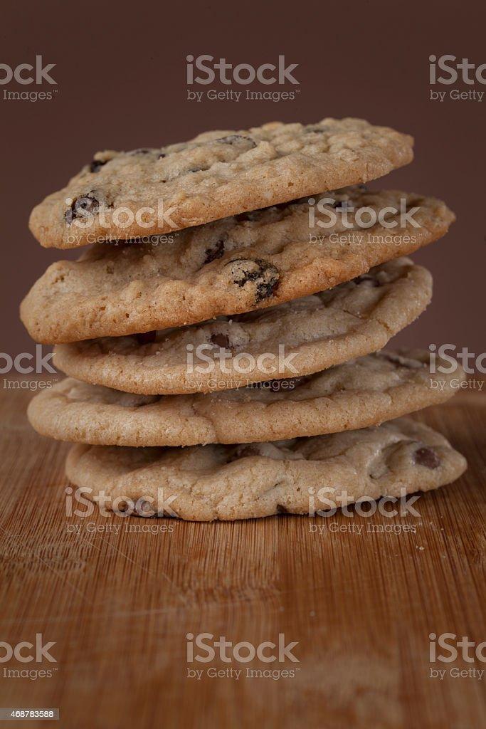 oatmeal raisin cookies on cutting board stock photo