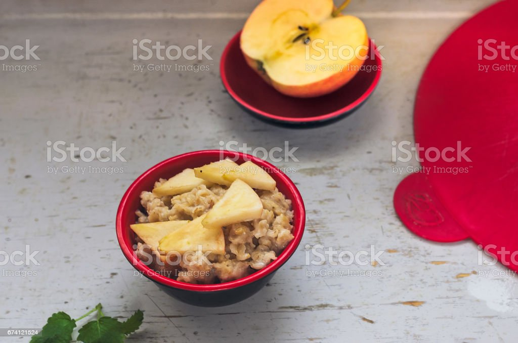 Oatmeal with apple in the bowl 免版稅 stock photo