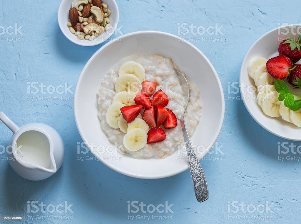 Oatmeal with banana and strawberries. Healthy delicious breakfast royalty-free stock photo