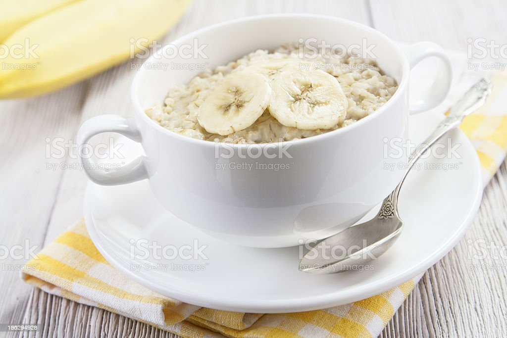 Oatmeal with bananas royalty-free stock photo