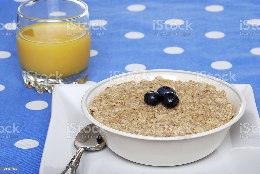 oatmeal with blueberries focus on berries royalty-free stock photo