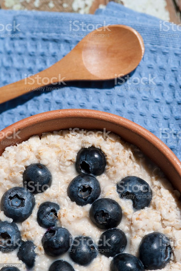 Oatmeal with blueberries on a blue towel stock photo