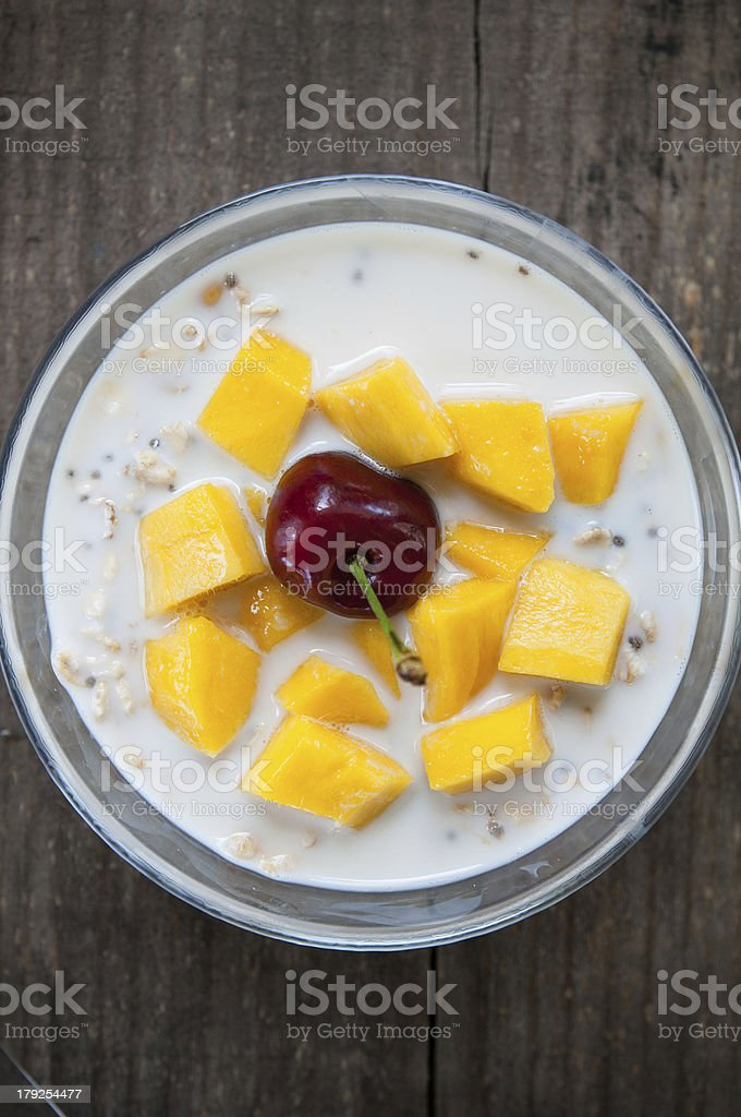 oatmeal with fresh mango & cherry royalty-free stock photo