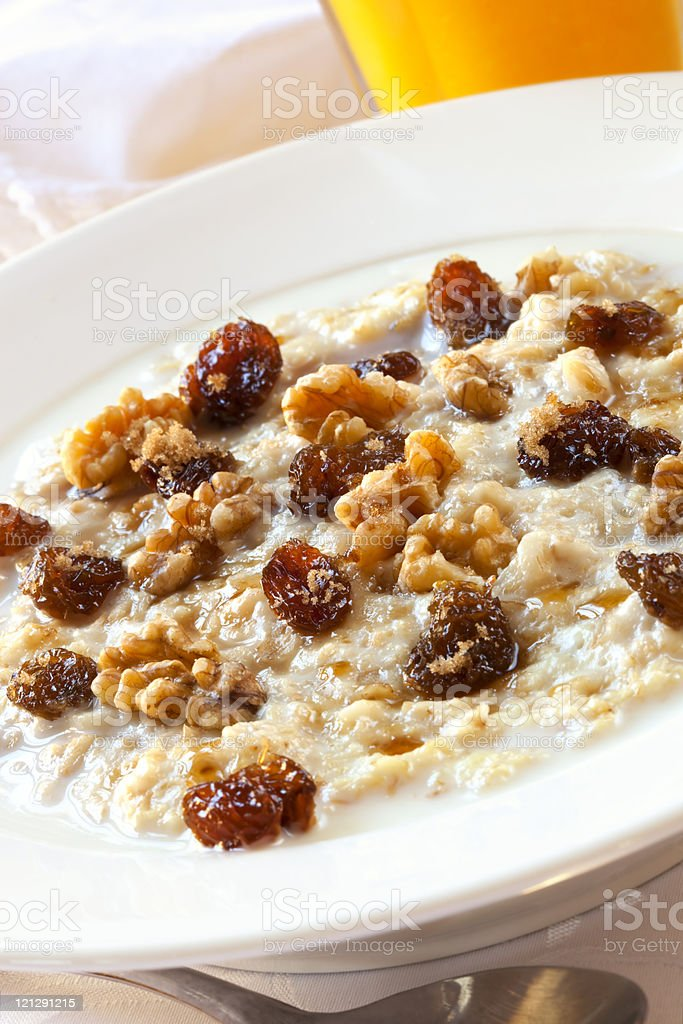 Oatmeal with Raisins and Walnuts royalty-free stock photo