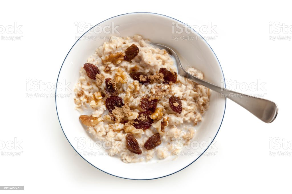 Oatmeal with Raisins Walnuts and Brown Sugar Isolated Top View stock photo